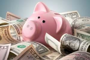 Piggy bank in pile of money