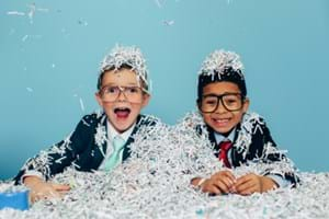 Kids covered in shredded paper