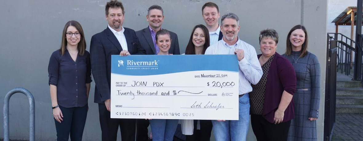 Rivermark team presenting a check donation to Join PDX.