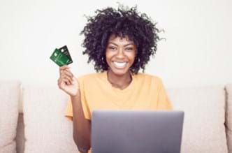 Woman holding two credit cards in her hand.