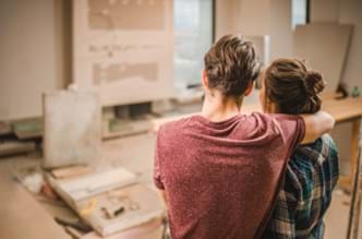 A couple admiring the remodeling work they are doing on their home.