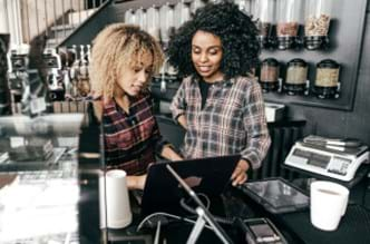 Two female employees at a cash register.