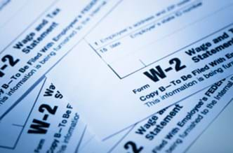 A stack of W-2 tax forms.